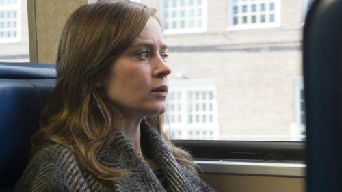 girl-on-the-train-looking-out-the-window