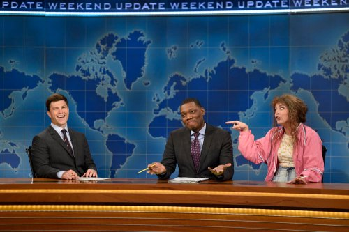 "SATURDAY NIGHT LIVE -- ""Margot Robbie"" Episode 1705 -- Pictured: (l-r) Colin Jost, Michael Che, and Cecily Strong as Cathy Ann during Weekend Update on October 1, 2016 -- (Photo by: Will Heath/NBC)"