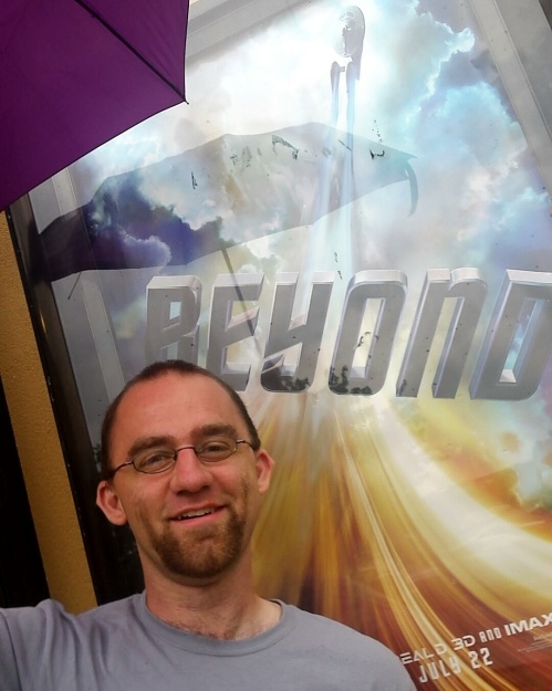 jeffrey_malone_with_umbrella_in_front_of_star_trek_beyond_poster